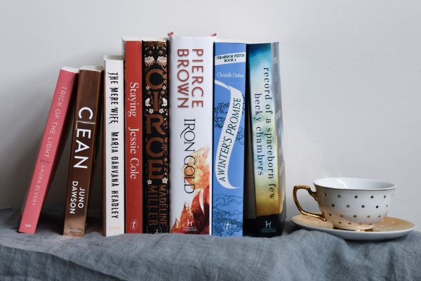 The books listed in the text below are stacked neatly next to a tea cup