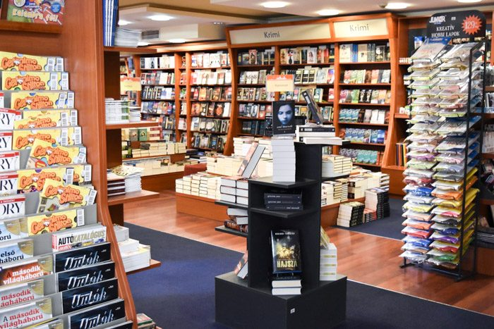 Interior of Alexandra bookshop showing a variety of different displays, some selling magazines, others selling paper and other stationery.