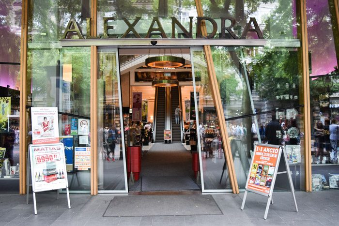 Picture of the front of Alexandra bookshop, with glass sliding doors opening up to a pair of escalators.