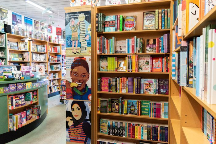 Picture of the inside of Lorne Beach Books, showing a shelf with middle grade and YA books.