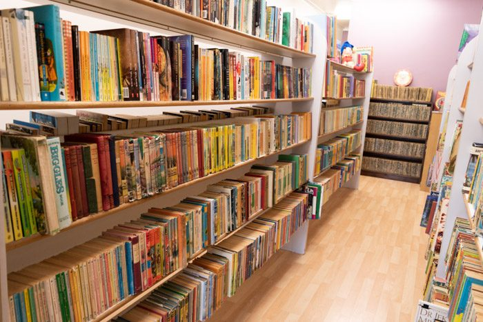 Picture of a lot of shelves with old children's books inside Spectrum Books.