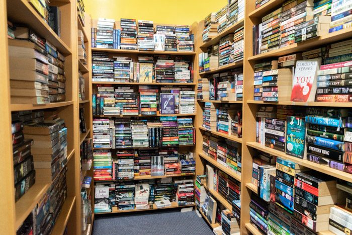 Picture of a shelving corner filled with mystery and thriller secondhand novels inside Spectrum Books.