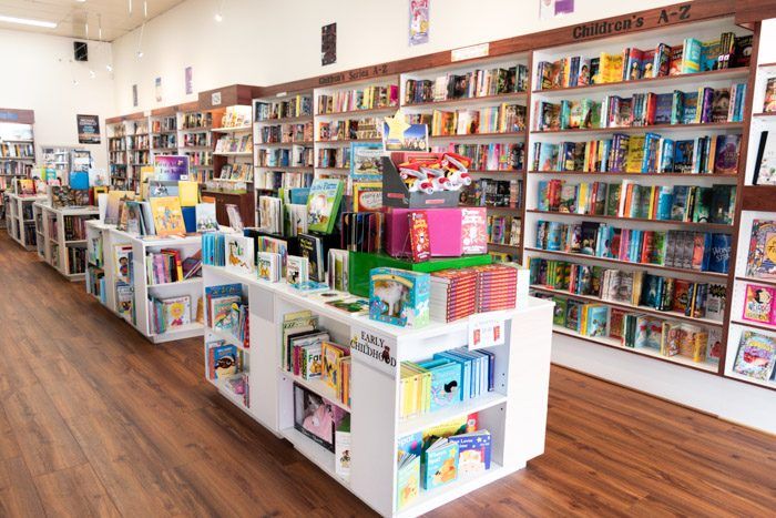 Picture of a long row of shelves and displays inside Warrnambool Books.