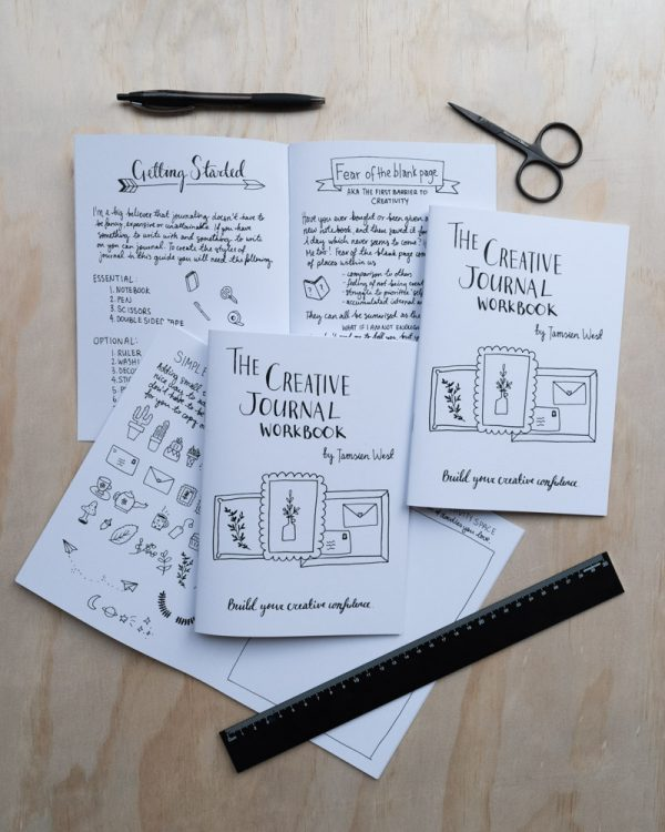 Several pages of a printed Creative Journal Workbook with assorted stationery