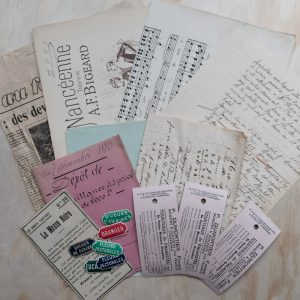 A selection of papers that would be enclosed in an example Marquis paper pack fanned out decoratively