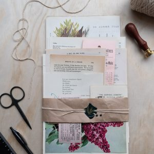 Bundle of vintage mixed papers with a nature theme, sealed with string and a wax stamp