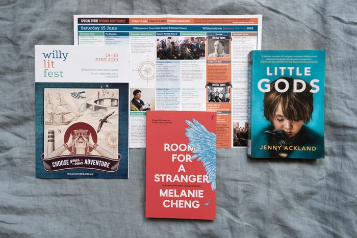 Willy Lit Fest: Top fiction picks, featuring Room for a Stranger by Melanie Cheng in the center and Little Gods by Jenny Ackland on the right, and the Willy Lit Fest program guide.