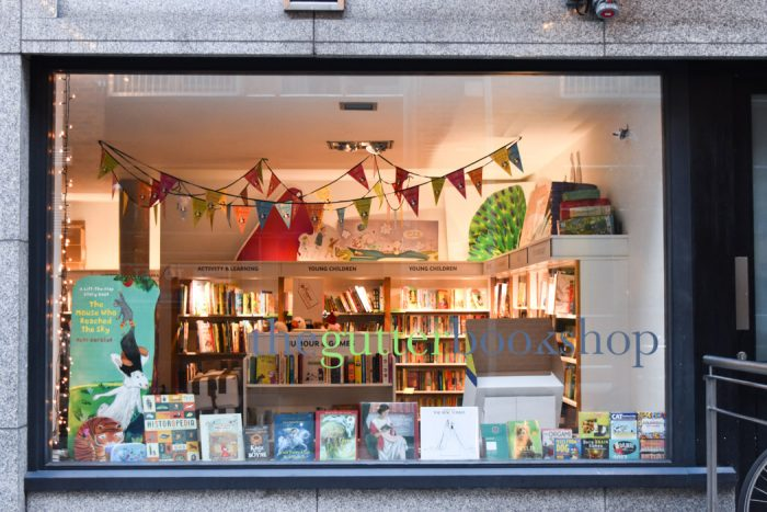 Window display of The Gutter Bookshop which displays a range of children's books