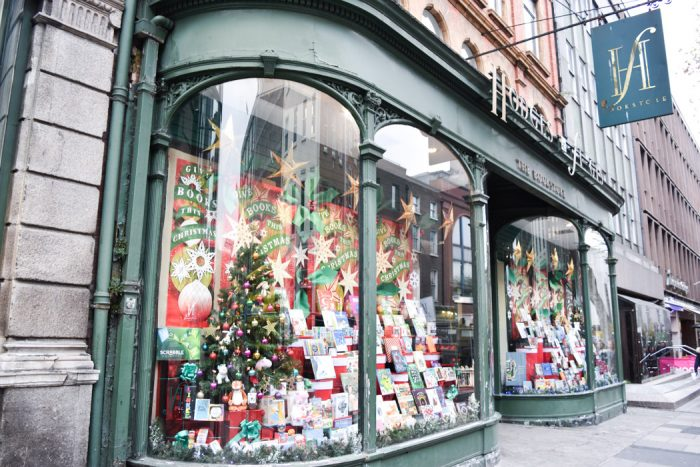 Prominent curved window display of the Hodges Figgis bookshop in Dublin with a Christmas theme.