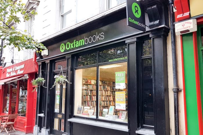 A black shopfront with the words Oxfam Books on the sign