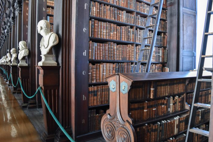 Close up of the wooden shelves in Trinity College library