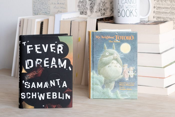 The book 'Fever Dream' next to the book 'My Neighbour Totoro'.
