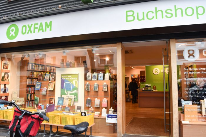 Exterior of Oxfam bookshop in Frankfurt showing a window display with a number of books for sale