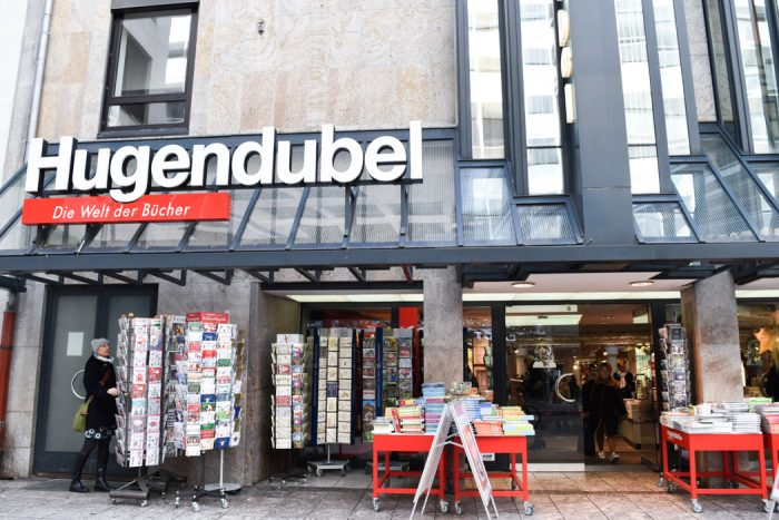 Front of Hugendubel bookshop with the shop name in large letters above the entrance