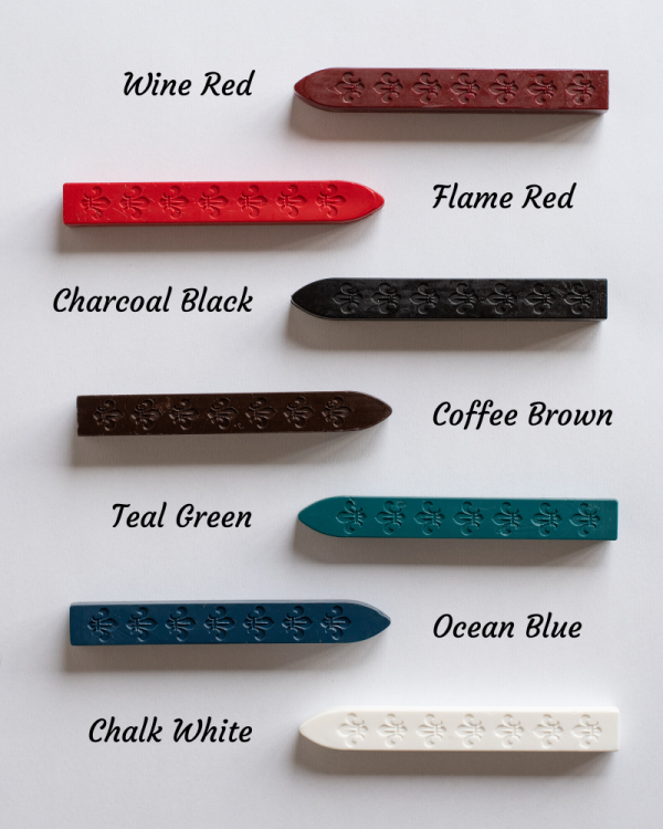 Wickless sealing wax sticks, one stick of each of the following colours is shown: Wine red, Flame red, charcoal black, coffee brown, teal green, ocean blue, and chalk white. On a plain white background.