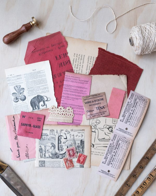 Rouge - Red vintage paper pack, featuring an assortment of red, pink and natural coloured vintage paper items like postage stamps and book pages.