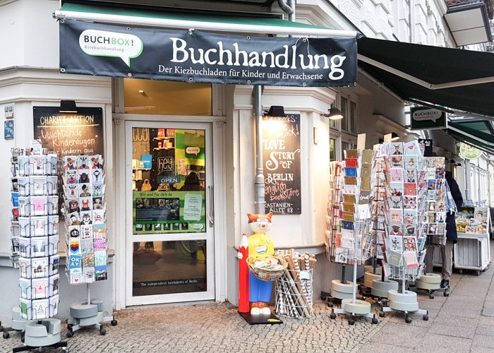 The front entrance to Buchbox, with several swiveling stands displaying gift cards for sale.