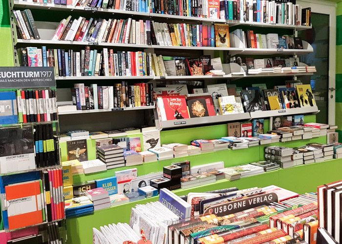 Green and grey bookshelves with a large range of German language books