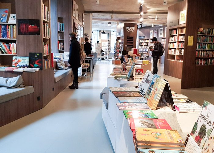 The interior of Ocelot bookshop, with several shoppers browsing the shelves.