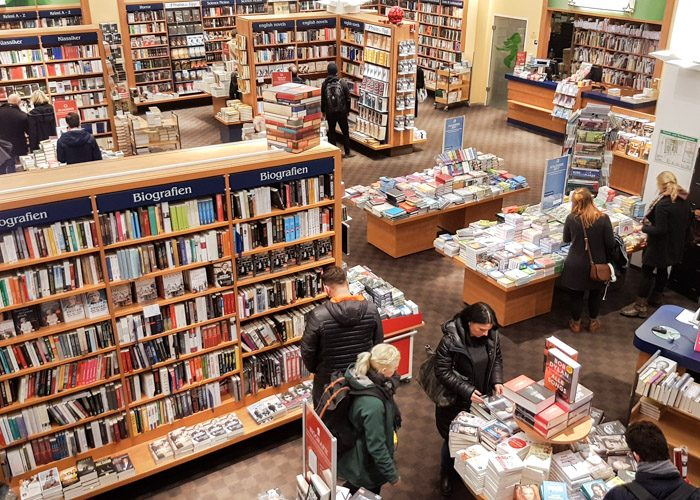 High angle shot of Thalia bookshop, which shows a number of people browsing the large amount of bookshelves